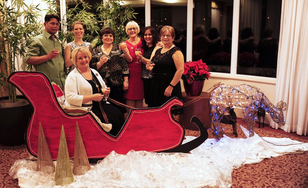 A group of women sitting on a sleigh at an Oakwood Park Retirement Community Event
